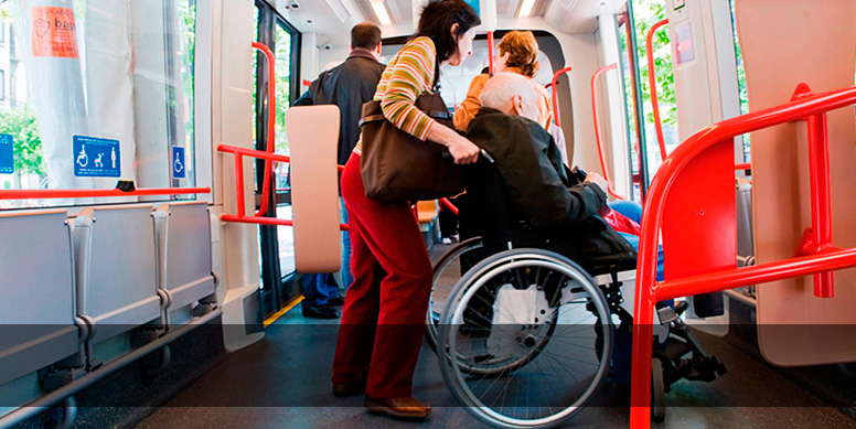 Passenger pushing a wheelchair, getting off the train